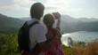 Traveler couple posing taking selfie using smartphone standing on top of mountain. 3840x2160
