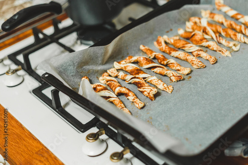 Valokuva  Spun puff pastry cookies on a baking sheet - home recipes