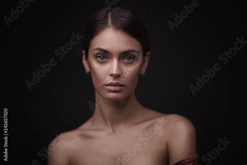 Beautiful face of young adult woman with clean fresh skin Canvas Print