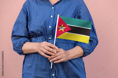 Mozambique flag  Close up of woman's hands holding