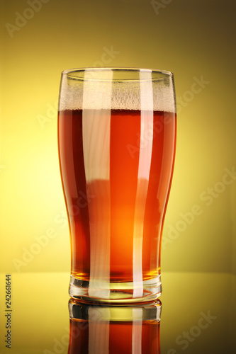 Tuinposter Bier / Cider Full Beer Glass with Yellow Background