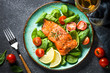 canvas print picture Baked salmon fish fillet with fresh salad top view.