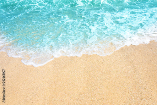 Foto auf Leinwand Turkis Soft wave of ocean on the sandy beach