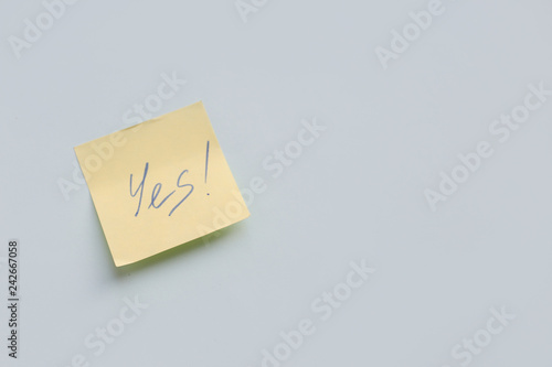 Photo text Yes on yellow paper sticker on the blue background, Success, Goal Concept