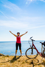 Healthy Lifestyle - Middle-aged Woman With Bike At Seaside