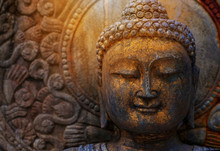 Rock Buddha Statue With Sunlig...