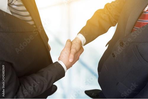 Valokuva  Business people handshaking at meeting on background