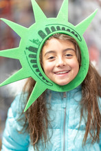 Happy Young Girl Wearing Statue Of Liberty Head Ring, New York City
