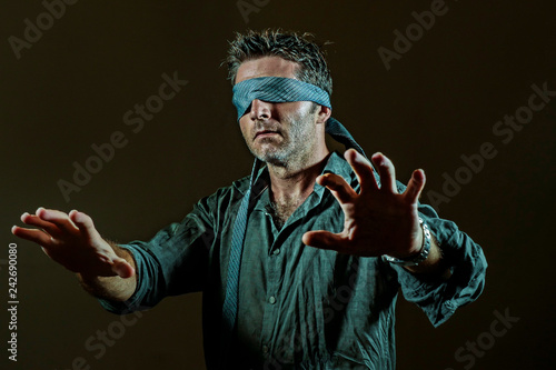 young lost and confused man blindfolded with necktie playing internet trend dang Canvas Print