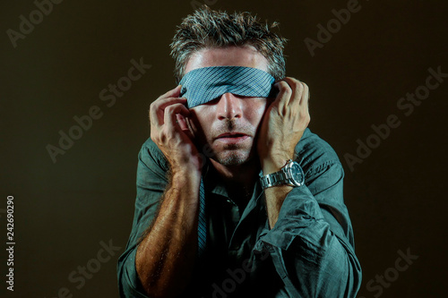 Obraz na plátně young lost and confused man blindfolded with necktie playing internet trend dang
