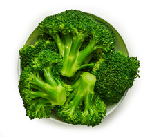 Steamed Broccoli In A Bowl Top View Isolated On White Background