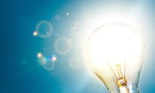 Standard Incandescent Light Bulb On Blue Background