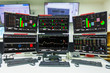 Display of Stock market quotes and chart in monitor computer room with business office equipments .business and money concept, panorama photo