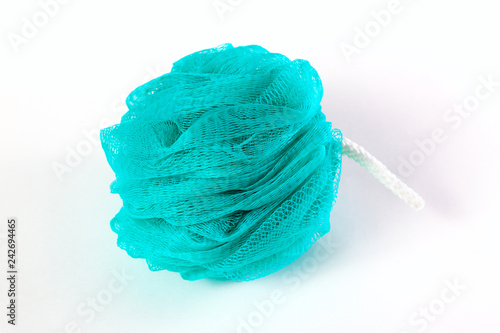 Fotografía fluffy blue washcloth isolated on white background