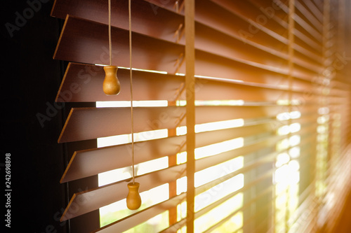 Photo Wooden blinds with sun light.