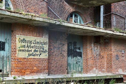 verfallenes VEB-Gelände in Wismar mit sozialistischen Losungen Canvas Print