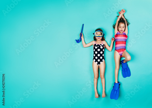 Fotografie, Obraz  Twin girls pretending to be snorkelling