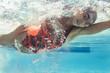 Leinwanddruck Bild - Young female swimmer in action