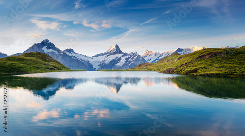 Photo Stands Lake Great view of the snow rocky massif. Location Bachalpsee in Swiss alps, Grindelwald valley.