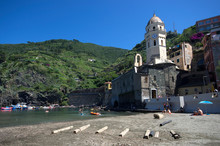Vernazza, Liguria / Italy - June 23 / 2016: People Having Fun At Beach Of Vernazza In Front Of Clock Tower