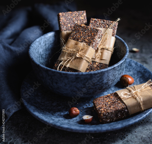 Chocolate chia seeds bars with hazelnuts, rolled oats, dates, coconut and honey