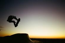 Silhouette Of Man Skateboardin...