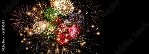 Fotografia Beautiful colorful fireworks  for celebration on dark background , New year holi