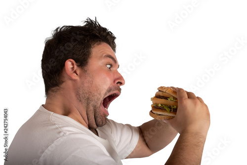Obraz na plátně Insatiable and hungry man eating a sandwich