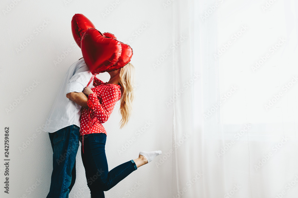 Fototapety, obrazy: Couple. Love. Valentine's day. Emotions. Man and woman are kissing behind the red heart-shaped balloons