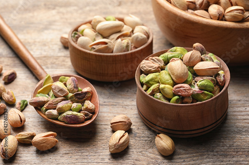 Composition with organic pistachio nuts on wooden table