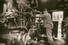 Railway Man Working On Steam Train Engine  - Retro Photography