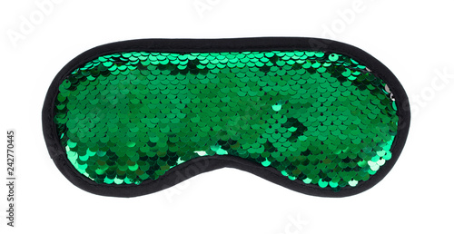 Fotografie, Obraz  Green sleeping eye mask with sequins that look like fish scales isolated on white background