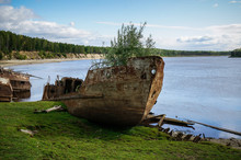 Abandoned Ship On The River Bank