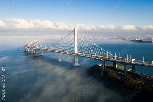 Fotobehang Bruggen San Francisco - Oakland Bay Bridge East Span With Low Fog in Background