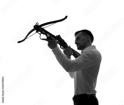 Leinwand Poster Portrait of young businessman with crossbow on white background