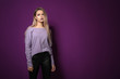canvas print picture - Fashionable young woman on violet background