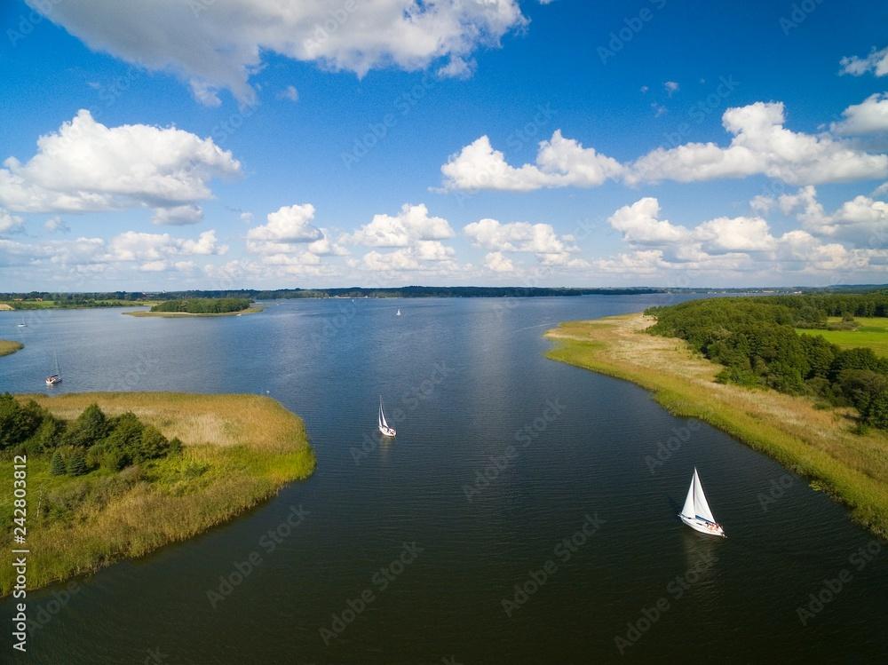 Aerial view of yachts sailing on Swiecajty Lake, Kal village (former Kehlen or Kielno, East Prussia), Mazury, Poland