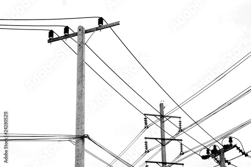 Fotografie, Obraz  electric pole power lines and wires on white background