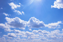 Many Clouds In Blue Sky. Sunny Day. Place For Text