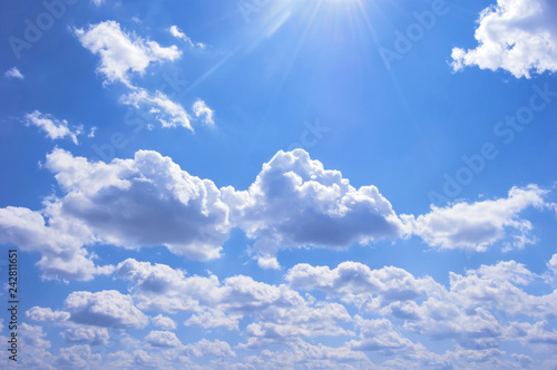 obraz lub plakat Many clouds in blue sky. Sunny day. Place for text
