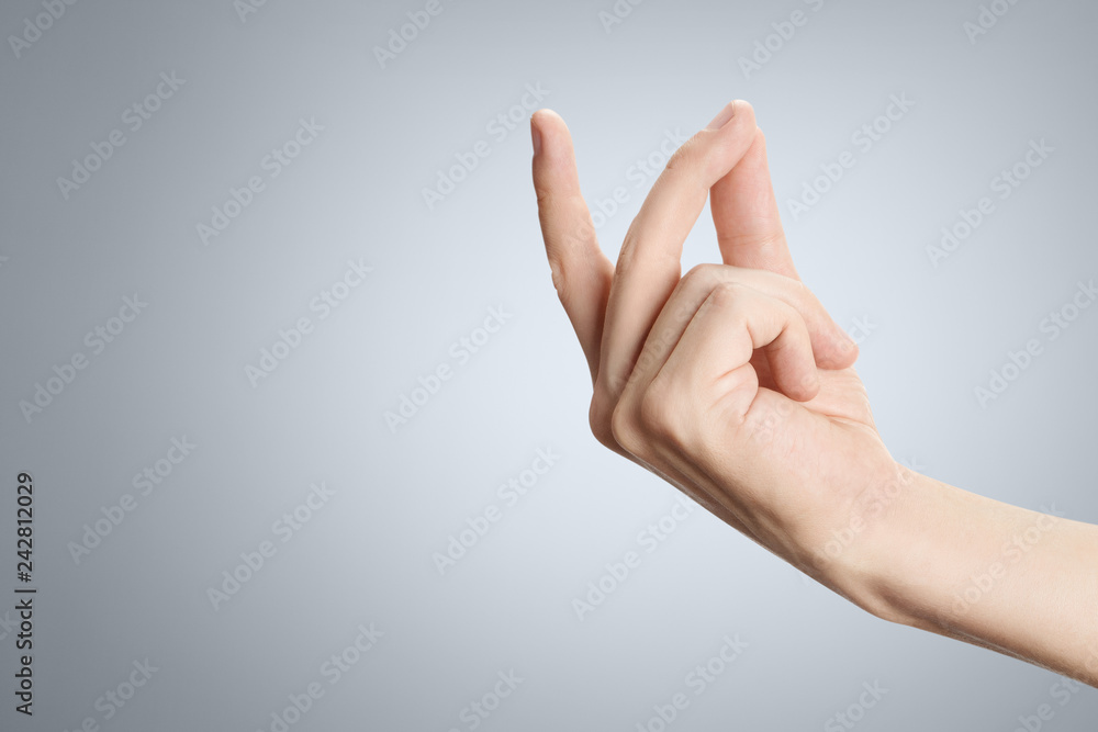 Fototapety, obrazy: Hand in a snapping gesture on grey background