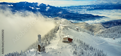 Fotografie, Obraz  Aerial view over the spectacular ski slopes in the Carpathians mountains, Panora