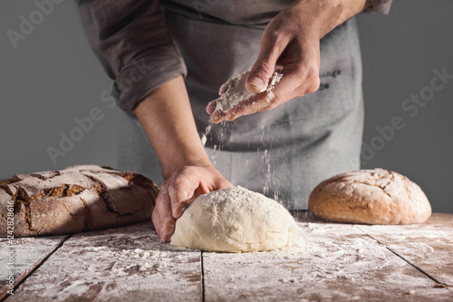 Chef making fresh dough for baking Canvas