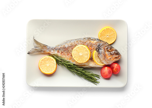 Fototapeta Plate with grilled dorado fish on white background