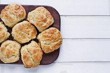 Fresh Buttermilk Southern Biscuits Or Scones Over A White Table Shot From Above. Top View.
