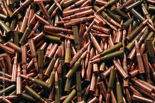 Different ammo on wooden background.