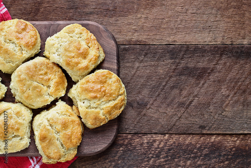 Fresh buttermilk southern biscuits or scones over a rustic wooden table shot from above Canvas Print