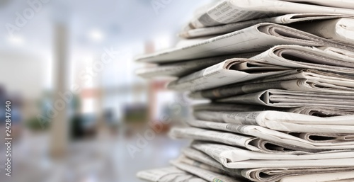 Photo  Pile of newspapers on white background