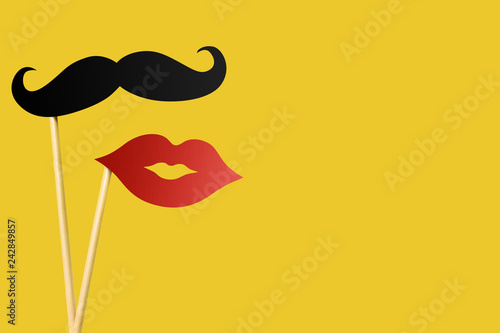 Fotografie, Obraz  Paper lips and moustache on wooden sticks on yellow background