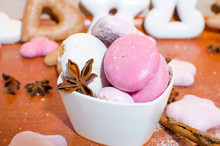 White And Pink Christmas Gingerbreads In A Bowl With A Star Anise And Cinnamon Sticks On A Wooden Kitchen Counter